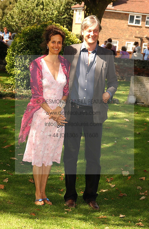 The MARQUESS &amp; MARCHIONESS OF WORCESTER she was actress Tracey Ward at the wedding of musician Jools Holland to Lady Crystabel Durham held at Cooling Village Church, Cooling, Kent on 30th August 2005.<br />