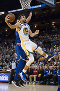 January 23, 2018; Oakland, CA, USA; Golden State Warriors guard Stephen Curry (30) shoots the basketball against New York Knicks center Enes Kanter (00) during the third quarter at Oracle Arena. The Warriors defeated the Knicks 123-112.