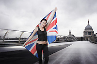 Olympic competitor with Union Jack in front of St Paul's Cathedral in London