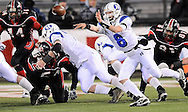 Hilliard's Jimmy Curtis flips the ball out to Jake Trubiano for the games' winning score on a 2-point conversion.  (Photo by David Richard/Ohiosportshooters.com)