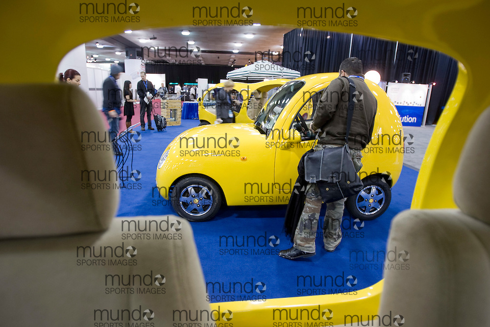 "GJR080086.JPG-20080114- A man looks at ""The Book of Songs"" electric car by Chinese manufacturer Li Shi Ming Automobile Design Company at the 2008 North American International Auto Show in Detroit, Michigan, 15 January 2008..AFP PHOTO/Geoff Robins"