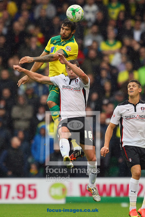 Bradley Johnson of Norwich and Frazer Richardson of Rotherham United in action during the Sky Bet Championship match at Carrow Road, Norwich<br /> Picture by Paul Chesterton/Focus Images Ltd +44 7904 640267<br /> 04/10/2014