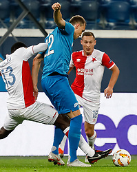 October 4, 2018 - Saint Petersburg, Russia - Artem Dzyuba (C) of FC Zenit Saint Petersburg vies for the ball with Michael Ngadeu-Ngadjui (L) and Jan Boril of SK Slavia Prague during the Group C match of the UEFA Europa League between FC Zenit Saint Petersburg and SK Sparta Prague at Saint Petersburg Stadium on October 4, 2018 in Saint Petersburg, Russia. (Credit Image: © Mike Kireev/NurPhoto/ZUMA Press)