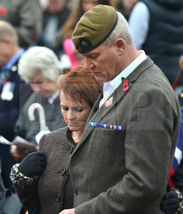 © Licensed to London News Pictures. 08/11/2015. Duxford, UK. Members of the public honour a minutes silence on Remembrance Sunday at Imperial War Museum Duxford, Cambridgeshire. Photo credit: Ben Cawthra/LNP