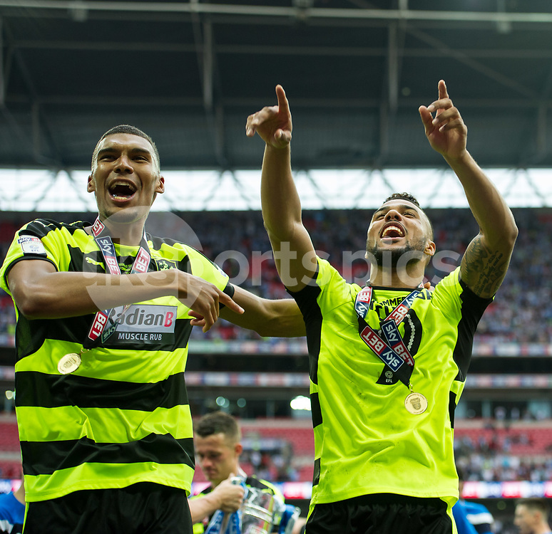 Elias Kachunga of Huddersfield Town celebrates the promotion during the EFL Sky Bet Championship Play-Off Final match between Huddersfield Town and Reading at Wembley Stadium, London, England on 29 May 2017. Photo by Salvio Calabrese.