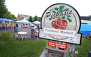A sign announcing newly located newly located Perkasie Farmers Market is seen Saturday June 20, 2015 in Perkasie, Pennsylvania.The farmers market relocated because of construction at the old site.  (Photo by William Thomas Cain)