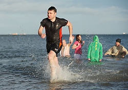 © Licensed to London News Pictures. 01/01/2013..Redcar, England..The annual New Year's Day dip goes down with a splash as people brave the chilly north sea to mark the beginning of a new year with an early morning dip at the beach in Redcar, Cleveland...Photo credit : Ian Forsyth/LNP