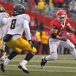 Dec 5, 2009; Piscataway, NJ, USA; Rutgers running back Joe Martinek (38) rushes around the outside during second half NCAA Big East college football action in West Virginia's 24-21 victory over Rutgers at Rutgers Stadium.