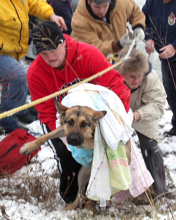 1221 A rescued German Shepherd is brought to shore after it fell through thin ice at Prairie Creek Reservoir Monday afternoon. According to rescue workers the dog was in the water for over one hour. Firefighters were able to break the ice and the dog swam to shore. .(Chris Bergin/ The Star Press)