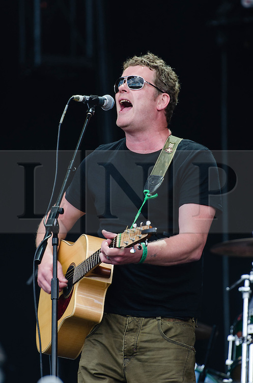 "© Licensed to London News Pictures. 31/07/2012. London, UK.  Dodgy perform live at BT London Live, Hyde Park.  Dodgy are an English power pop rock trio, that rose to prominence during the Britpop era of the 1990s. They are best known for their hits ""Staying Out for the Summer"", ""If You're Thinking of Me"", and ""Good Enough"".  In this pic - Nigel ClarkPhoto credit : Richard Isaac/LNP"