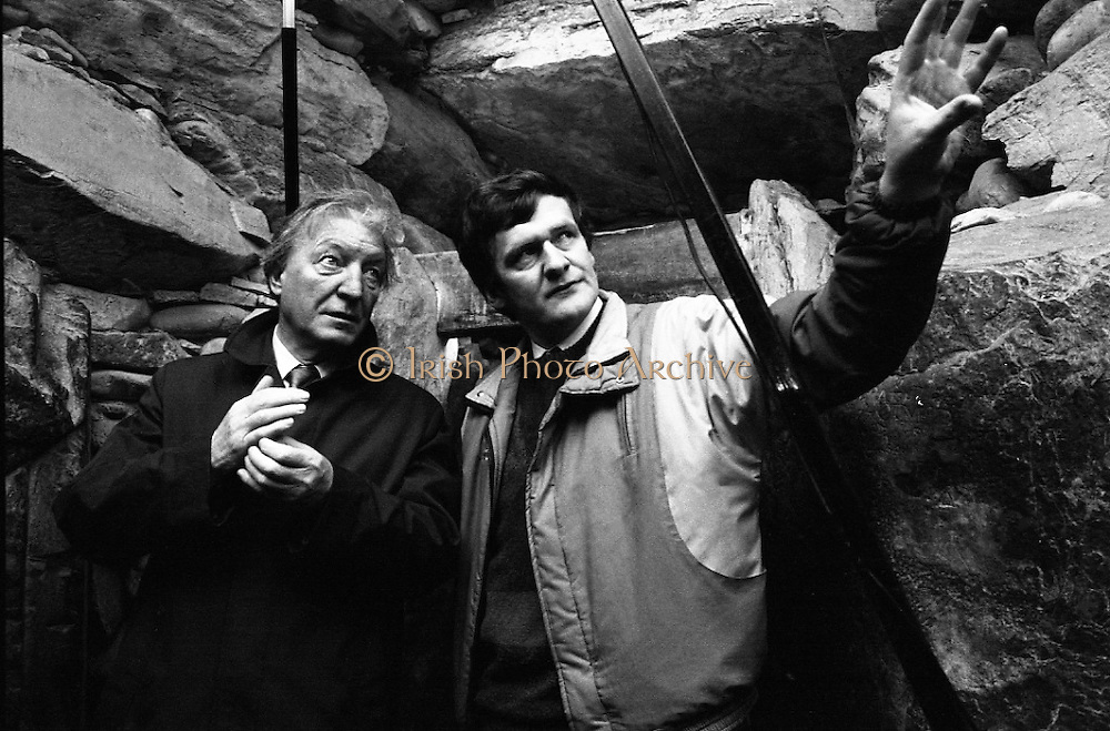 Taoiseach Visits Newgrange.  (R70)..1987..21.12.1987..12.21.1987..21st December 1987..An Taoiseach, Charles Haughey TD, visited the Newgrange Stoneage Chamber to view thwe annual Winter Soltice. As the sun rose, An Taoiseach watched as the sunrise traced its path along the floor of the chamber...Dr Tim O'Brien is pictured pointing out the significant points of the chamber to An Taoiseach, Charles Haughey.