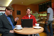 Janus Friis, Danish 27 years of age (in red sweater) and Niklas Zennström, 37 years of age (in blue shirt and grey jacket), Swedish, are the two founders of Skype (www.skype.com) the worlds first peer-to-peer telephony service, which has been downloaded in excess of one million copies since its was unleashed one month ago...