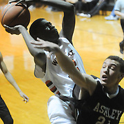 New Hanover's Ramello Williams shoots over Ashley's Josh Smiley Friday December 19, 2014 at New Hanover High School in Wilmington, N.C. (Jason A. Frizzelle)