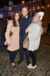 Left to right, BIANCA TRISTAO, HAMISH KHAYAT and his sister HELENA KHAYAT at Skate at Somerset House in association with Fortnum & Mason held on 10th November 2014.