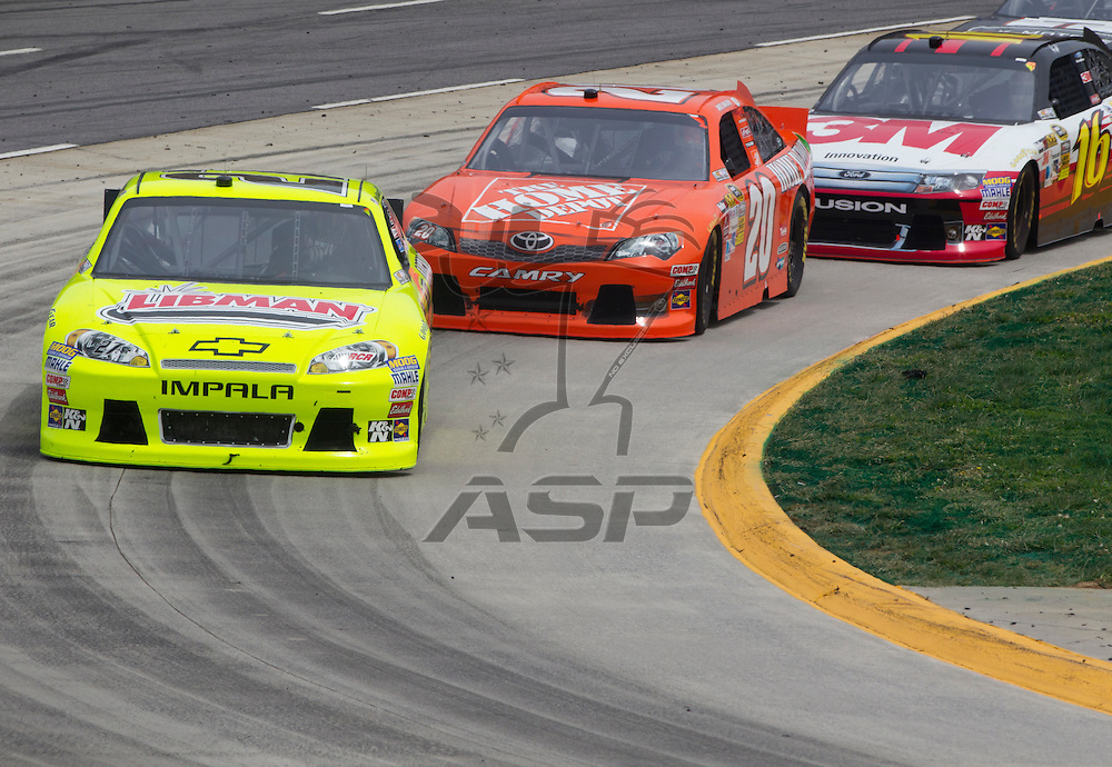 Martinsville, VA - MAR 01, 2012:  Paul Menard (27) races for position during the Goody's Fast Relief 500 race at the Martinsville Speedway in Martinsville, VA.