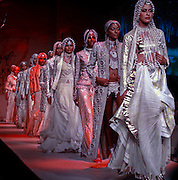 Models present creations by Indian designer Rohit Bal during the Lakme India Fashion Week in New Delhi, Monday, April 25, 2005. (AP Photo/Sebastian John)
