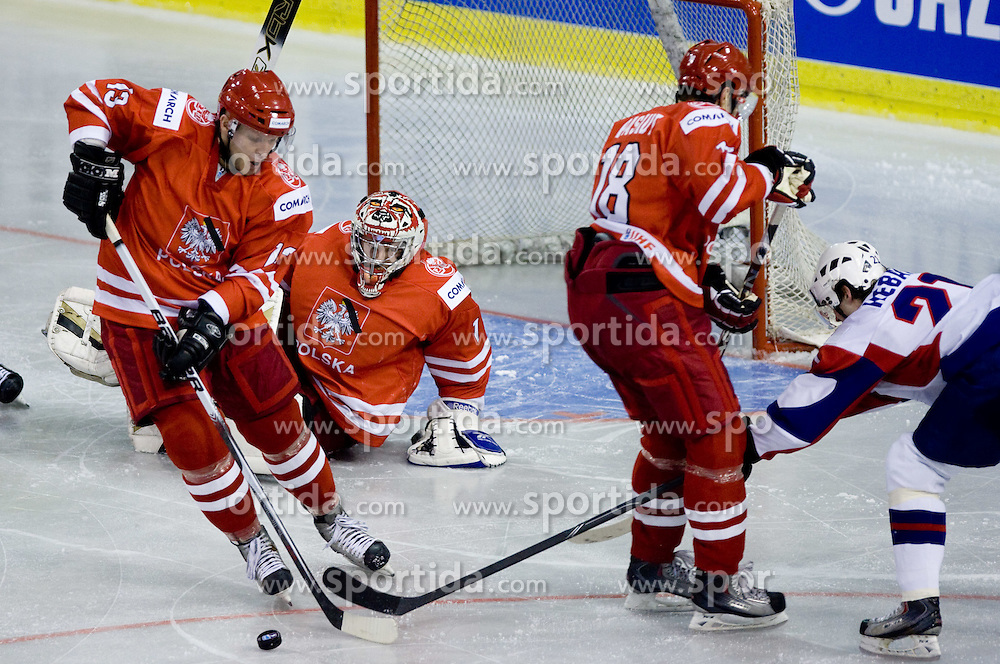 Marian Csorich and goalkeeper of Poland Krzysztof Zborowski vs Andrej Hebar of Slovenia at IIHF Ice-hockey World Championships Division I Group B match between National teams of Slovenia and Poland, on April 17, 2010, in Tivoli hall, Ljubljana, Slovenia. (Photo by Vid Ponikvar / Sportida)