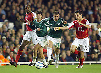 Fotball<br /> Champions League 2004/05<br /> Arsenal v Panathinaikos<br /> 2. november 2004<br /> Foto: Digitalsport<br /> NORWAY ONLY<br /> The double assault of Panathinaikos' Ezequiel Gonzalez (l) and Dimitrios Papadopoulos disposses the Arsenal midfield duo Francesc Fabregas (r) and Patrick Vieira (far left)