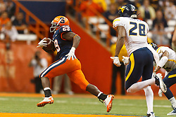 Oct 21, 2011; Syracuse NY, USA;  Syracuse Orange running back Antwon Bailey (29) rushes past West Virginia Mountaineers defensive back Terence Garvin (28) during the fourth quarter at the Carrier Dome.  Syracuse defeated West Virginia 49-23. Mandatory Credit: Jason O. Watson-US PRESSWIRE