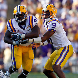 Oct 2, 2010; Baton Rouge, LA, USA; LSU Tigers running back Stevan Ridley (34) takes a hand off from quarterback Jordan Jefferson (9) during the second half against the Tennessee Volunteers at Tiger Stadium. LSU defeated Tennessee 16-14.  Mandatory Credit: Derick E. Hingle