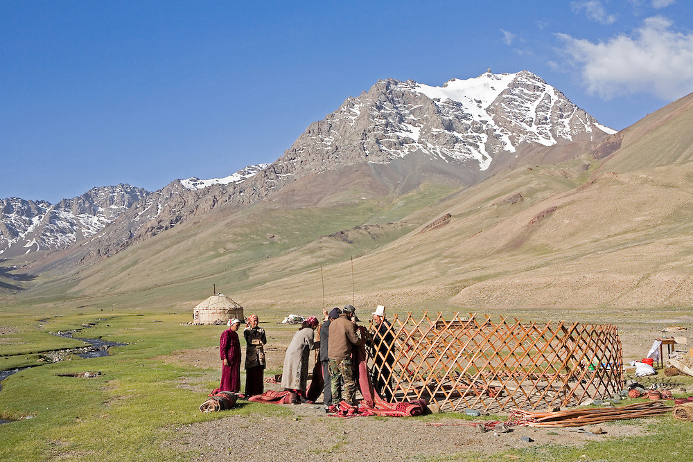 Series of Kyrgyz family assembling their yurt in the Pshart Valley of Tajikistan's eastern Pamir Mountains
