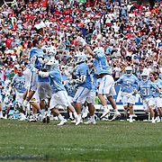 North Carolina Attackman CHRIS CLOUTIER (45), right, celebrates with teammates after scoring the game winning goal in overtime of The NCAA Division I NATIONAL CHAMPIONSHIP GAME between North Carolina and Maryland, Monday, May. 30, 2016 at Lincoln Financial Field in Philadelphia, Pa