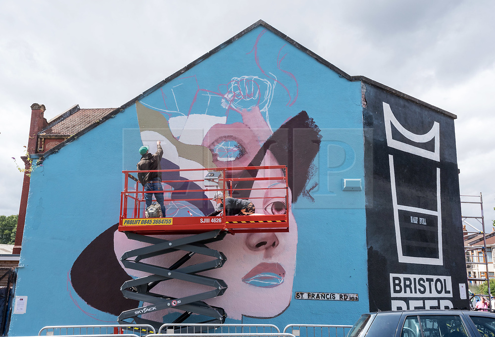 © Licensed to London News Pictures.  28/07/2018; Bristol, UK. Upfest, The Urban Paint Festival, 2018 with themes this year including the Simpsons cartoon series and 100 years of the first women getting the vote. Upfest which is Europe's largest Street Art and Graffiti Festival takes place in the Bedminster area of Bristol between Saturday the 28th and Monday 30th of July. In celebration of their 10th anniversary, Upfest will feature the animated family, The Simpsons with 2018 festival goers treated to artist interpretations including Homer, Marge, Bart, Lisa, and Maggie. The festival has also teamed up with Bristol Women's Voice to celebrate the centenary of the first votes for women, and together Upfest and Bristol Women's Voice will celebrate the progress made since 1918, with three artists including Nomad Clan chosen to portray the suffrage movement and the rights of women. Upfest will have 400 artists from 70 countries in attendance, including this year's lead artists Insane51, L7m, London Police, Nomad Clan, Odeith, and Paris. This year, three Upfest artists have been selected by The Simpsons creator Matt Groening to bring The Simpsons to life in their own unique styles: Bao, born and based in Hong Kong, is known for her freestyle work with vibrant murals and illustrations; Soker, a wildstyle writer, is one of Bristol's finest talents and has been putting his mark on the city since the late 80's; Nomad Clan, the collective of Cbloxx and AYLO, one of the most sought-after duos in the international global street art scene. Upfest will be raising money for The National Association for Children of Alcoholics (NACOA) which offers aid and assistance for children growing up in families affected by alcoholism. Photo credit: Simon Chapman/LNP