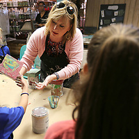 """Bev Crossen, owner of Farmhouse in Tupelo, hepls her art students with their """"Chalk Paint Pour"""" project at their Art/DIY Camp at Farmhouse in Tupelo on Tuesday morning."""