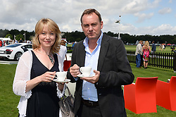 BETH GODDARD and PHILIP GLENISTER at the Audi International Polo at Guards Polo Windsor Great Park, Egham, Surrey on 28th July 2013.