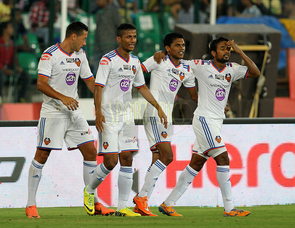 Romeo Fernandes of FC Goa celebrates a goal with his teammates during match 50 of the Hero Indian Super League between Chennaiyin FC and FC Goa held at the Jawaharlal Nehru Stadium, Chennai, India on the 5th December 2014.<br /> <br /> Photo by:  Vipin Pawar/ ISL/ SPORTZPICS