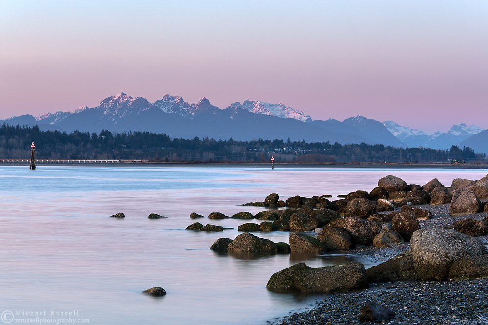 Earth's shadow and the Golden Ears (Mount Blandshard) after sunset.  Photographed from Blackie Spit at Crescent Beach, Surrey, British Columbia, Canada