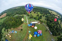 © Licensed to London News Pictures. 08/08/2019; Bristol, UK. Views from the Kubicek balloon with pilot Doug Hoddinott on the morning mass ascent of over 50 balloons at the 41st Bristol International Balloon Fiesta 2019 which takes place from 08 - 11 August 2019. For the first time in the event's history the first mass ascent of the fiesta was brought forward a day early due to the forecast for bad weather on Friday and Saturday. The Bristol International Balloon Fiesta attracts hundreds of thousands of visitors and this year the Fiesta will be celebrating Icons of Bristol and look to highlight some of the things that make up the home of the International Balloon Fiesta. The event has joined forces with Aerospace Bristol to honour one of the city's most famed creations, Concorde and Aardman Animations who are celebrating the 30th anniversary of Wallace and Gromit. Photo credit: Simon Chapman/LNP.