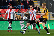 Archie Collins (27) of Exeter City battles for possession with Liam O'Neil (8) of Cambridge United during the EFL Sky Bet League 2 match between Exeter City and Cambridge United at St James' Park, Exeter, England on 11 January 2020.