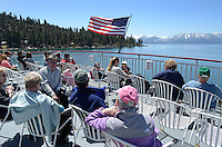 Passengers, after deck. MS Dixie II, paddle steamer, which operates from Zephyr Cove, Nevada, USA, is the largest vessel on South Lake Tahoe. The lake itself is split vertically between Nevada in the East and California in the West. It traverses the lake from Zephyr Cove to Emerald Bay in California. The snow-capped mountains are in California. 201304261818<br /> <br /> Copyright Image from Victor Patterson, 54 Dorchester Park, Belfast, UK, BT9 6RJ<br /> <br /> Tel: +44 28 9066 1296<br /> Mob: +44 7802 353836<br /> Voicemail +44 20 8816 7153<br /> Skype: victorpattersonbelfast<br /> Email: victorpatterson@me.com<br /> Email: victorpatterson@ireland.com (back-up)<br /> <br /> IMPORTANT: If you wish to use this image or any other of my images please go to www.victorpatterson.com and click on the Terms & Conditions. Then contact me by email or phone with the reference number(s) of the image(s) concerned.