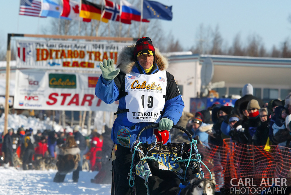 3/4/2007:  Willow, Alaska -  Alaskan favorite, Veteran Martin Buser of Big Lake, AK, waves to the crowd as he starts the long trip to Nome in the 35th Iditarod Sled Dog Race