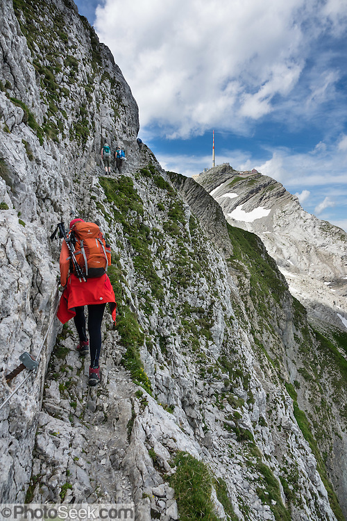 Weaving through limestone outcroppings, we hiked the stunning Lisengrat, a sinuous chain-protected trail from Rotsteinpass to the summit of Säntis. The Lisengrat is a magnificent ridge route between Säntis (2502 m / 8218 feet elevation) and Altmann (2435 m / 7989 ft), the two highest peaks in Appenzell's Alpstein range. The rocky route is safe, but can be scary for those with fear of heights. Shared by three cantons, Säntis can be reached easily via cable car or with effort via trails, to see vast mountain views across six countries: Switzerland, Germany, Austria, Liechtenstein, France and Italy. The Appenzell Alps rise between Lake Walen and Lake Constance. For licensing options, please inquire.