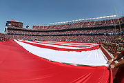 The American flag is stretched out across the field in a show of patriotism during pregame ceremonies before the San Francisco 49ers 2017 NFL week 1 regular season football game against the Carolina Panthers, Sunday, Sept. 10, 2017 in Santa Clara, Calif. The Panthers won the game 23-3. (©Paul Anthony Spinelli)
