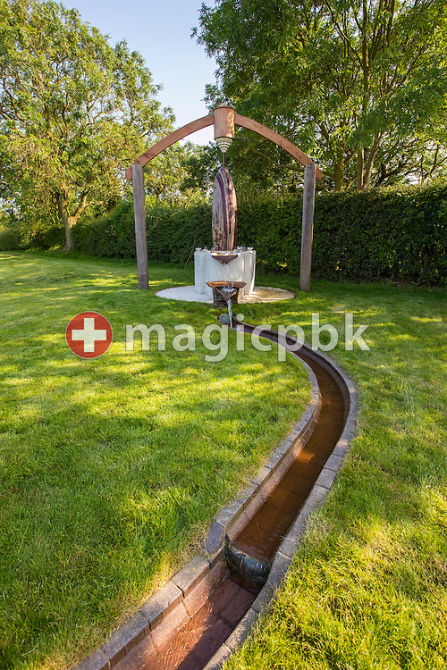 The water source and the Shiva Lingam in the garden at Aura-Soma Products Ltd. in Tetford, Lincolnshire, Great Britain, Friday, June 20, 2014. (Photo by Patrick B. Kraemer / MAGICPBK)