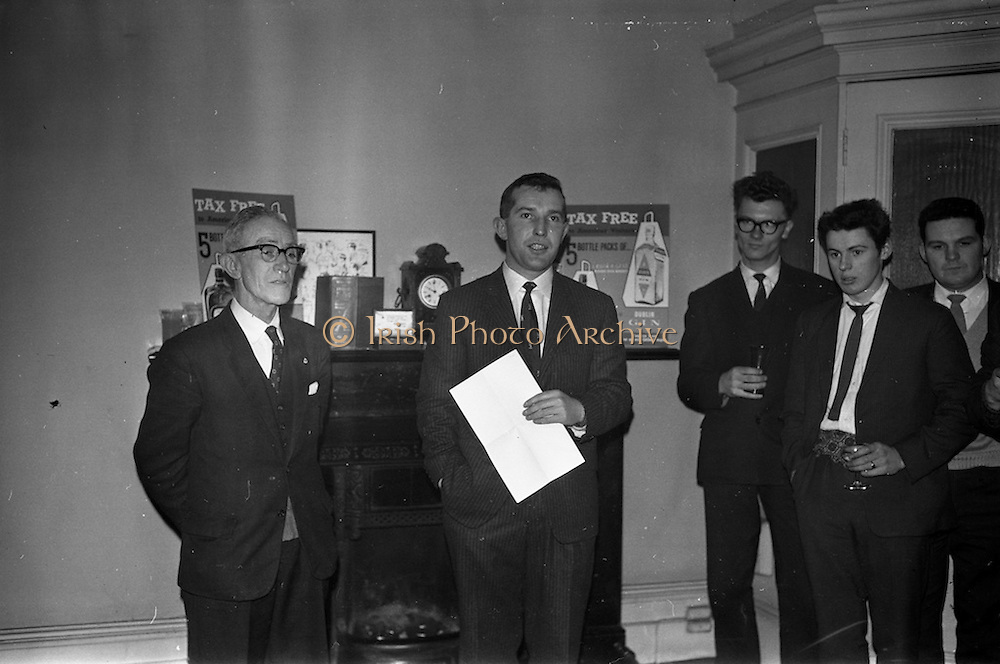 13/02/1963<br /> 02/13/1963<br /> 13 February 1963<br /> Retirement presentation at Gilbeys of Ireland Ltd., Dublin. A presentation of a cheque for £100 and a gold watch was made to Paddy Slater (65), on his retirement after 49yrs and 7 months service with the company. A sum of money was also presented by the staff. Picture shows: Mr. Ian Cairnduff, Director Gilbeys (centre) making the presentation speech, Mr. Slater on the left.