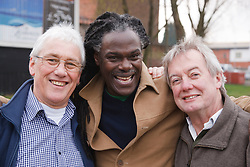 Three men together laughing. Cleared for Mental Health issues.