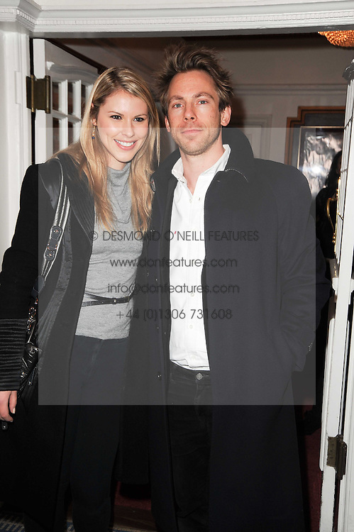 PETRINA KHASHOGGI and JAMES FABRICANT at an In-House screening of 'Sweet Smell of Success' hosted by Clive Owen presented by Tod's in association with Amend held at The Electric Cinema, 191 Portobello Road, London W11 on 29th November 2010.