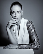 Black and white portrait of Anna a young woman with a full sleeve tattoo. Photo by Bristol based photographer Jonathan Bowcott