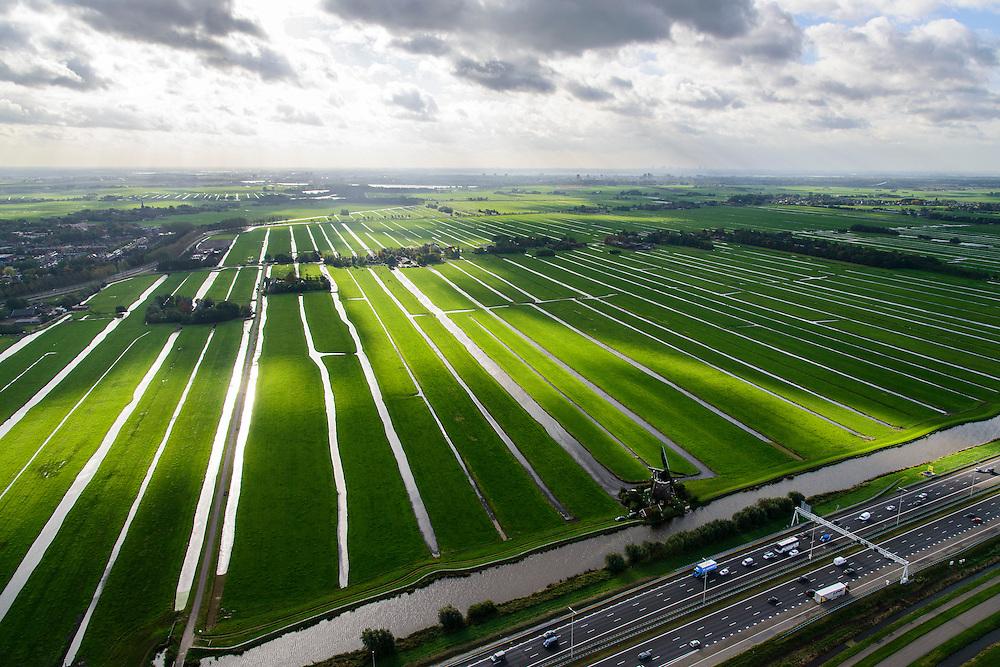 Nederland, Zuid-Holland, Stompwijk, 23-10-2013; A4 tussen Leiden en Leidschendam, zicht op het Groene Hart met windturbines en poldermolen.<br /> Motorway A4 and green polder in the West of the netherlands, the Green Heart.<br /> luchtfoto (toeslag op standaard tarieven);<br /> aerial photo (additional fee required);<br /> copyright foto/photo Siebe Swart.