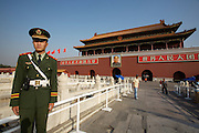 Tian'anmen Square (Place of Heavenly Peace). Tian'anmen Gate. Mao portrait and policeman.