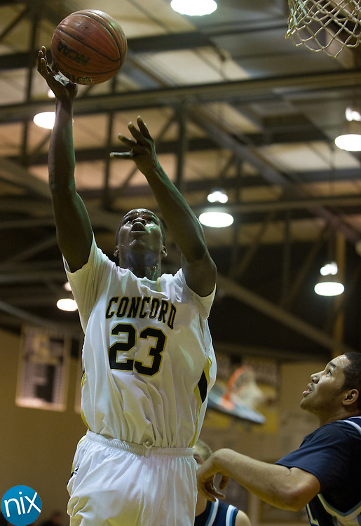 Concord's Xavier Stywall takes a shot against Hopewell Wednesday night at Concord High School. The Spiders defeated Hopewell 100-78. (Photo by James Nix)