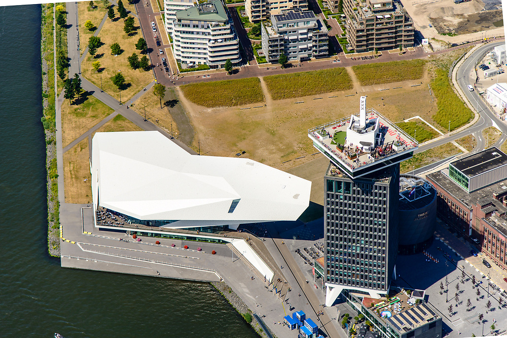 Nederland, Noord-Holland, Amsterdam-Noord, 29-06-2018; Buiksloterham,  Overhoeks, voormalig Shell Research-terrein. Huisvest nu onder andere filmmuseum EYE (EYE Film Instituut Nederland), de toren Overhoeks, de A'DAM Lookout toren, Tolhuistuin, Oeverpark.<br /> Overhoeks, a new city district on the IJ bank in Amsterdam-North.<br /> <br /> luchtfoto (toeslag op standard tarieven);<br /> aerial photo (additional fee required);<br /> copyright foto/photo Siebe Swart