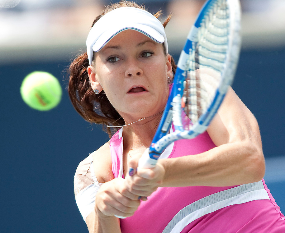 Agnieszka Radwanska of Poland  returns a shot during her semi-final match against Samantha Strosur of Australia at the Rogers Cup WTA event in Toronto, Ontario, August 13, 2011. Strosur defeated Radwanska in 3 sets.<br /> AFP PHOTO/Geoff Robins