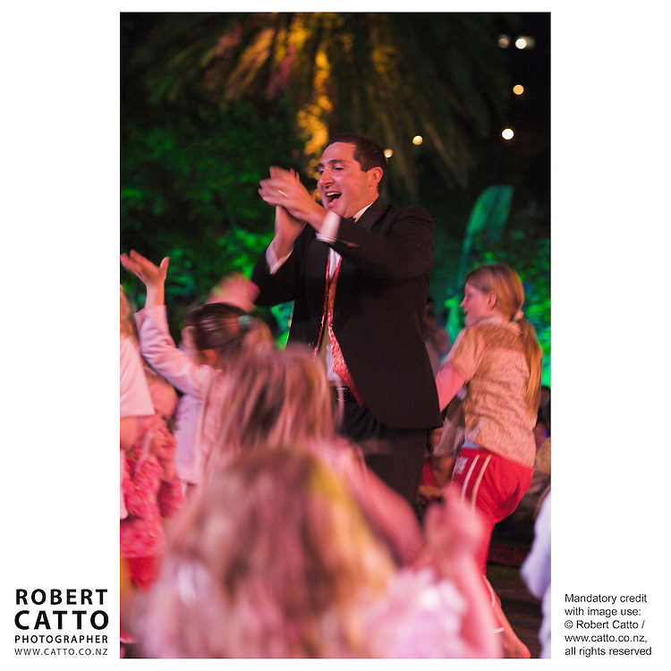 Conductor Owen Clark dances with children in the audience as the Vector Wellington Orchestra perform at the ASB Gardens Magic / Summer City Festival 2007 at the Wellington Botanic Garden, Wellington, New Zealand.
