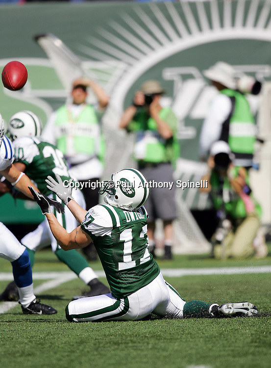 EAST RUTHERFORD, NJ - OCTOBER 1:  Tim Dwight #17 of the New York Jets catches a punt while sitting on his behind during the game against the Indianapolis Colts at the Meadowlands on October 1, 2006 in East Rutherford, New Jersey. The Colts defeated the Jets 31-28. ©Paul Anthony Spinelli *** Local Caption *** Tim Dwight