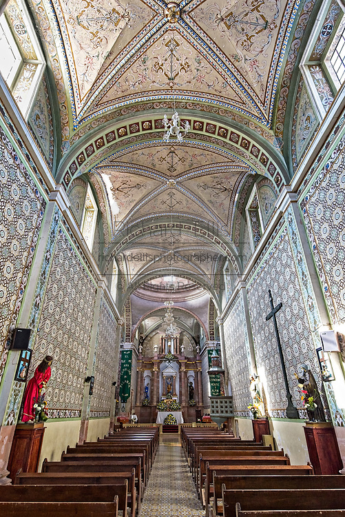 Interior of the Parroquia de San Pedro Apóstol church or Saint Paul the Apostle provincial church in Mineral de Pozos, Guanajuato, Mexico. The town, once a major silver mining center was abandoned and left to ruin but has slowly comeback to life as a bohemian arts community.